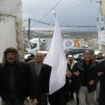 Sulha procession under the Riya flag